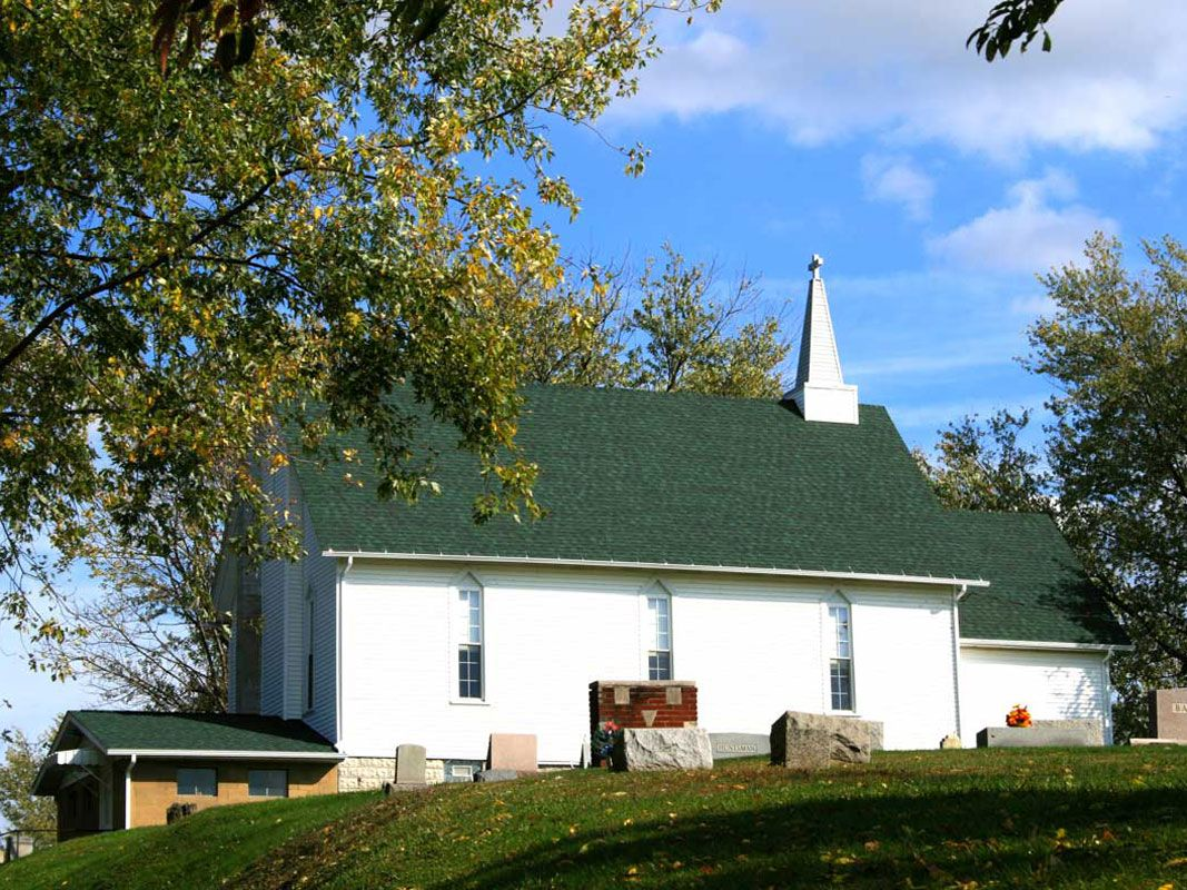 Green Shingled Church Roofing