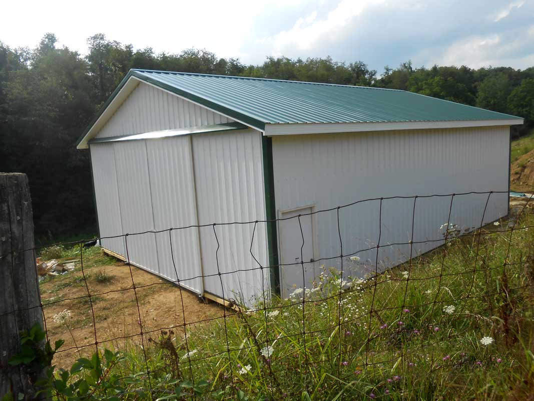 Shed with Standing Seam Green Metal Roofing