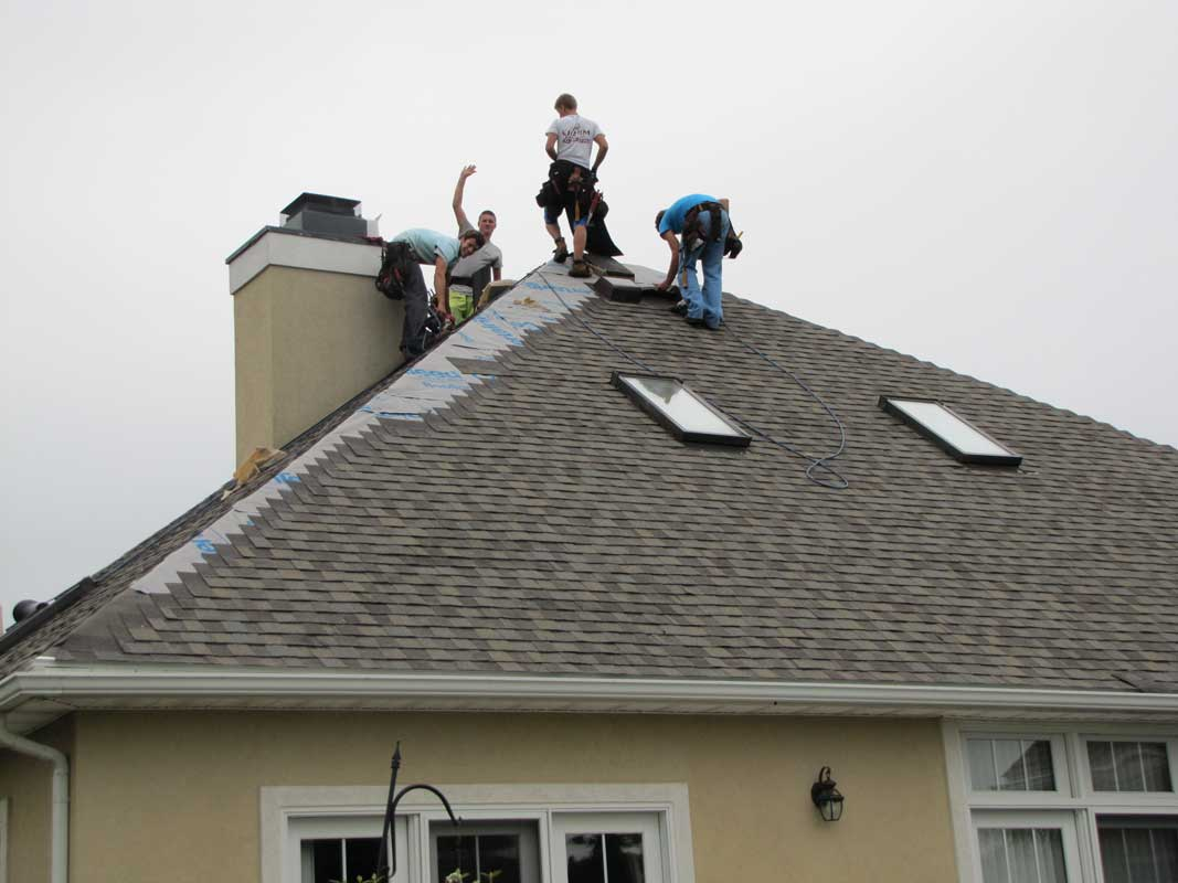 Amish asphalt shingle installation crew