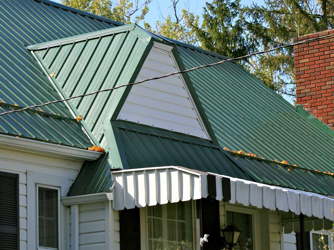 New green metal roofing on House