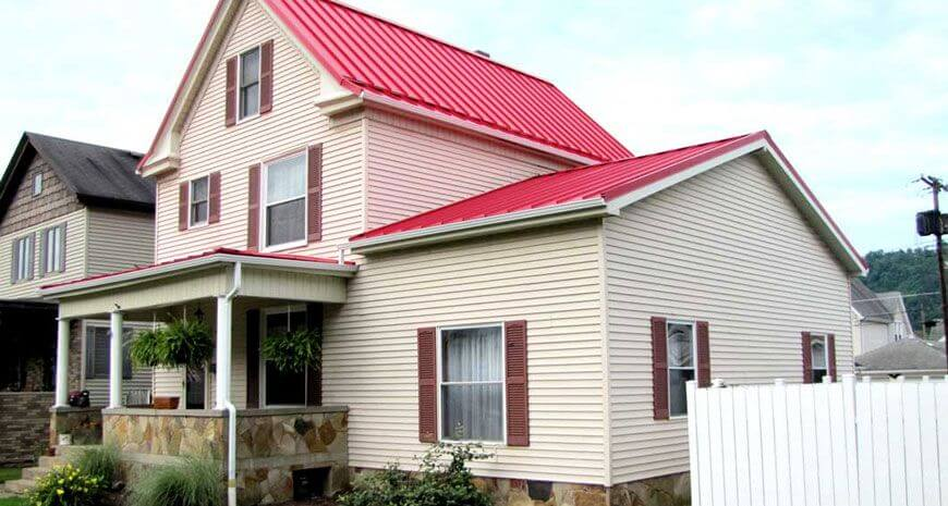 Red Standing seam metal roofing installed by us